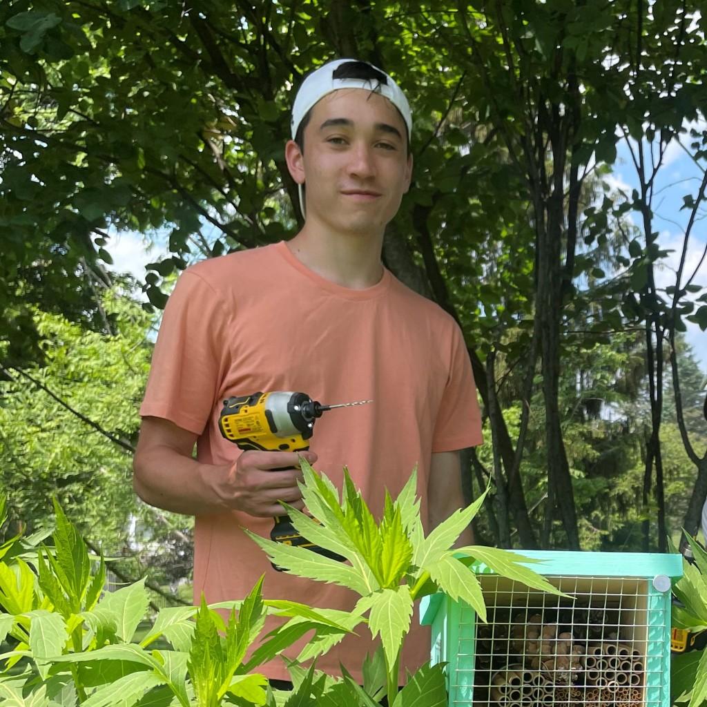 Student researcher, Matt Look, installing bee hotel